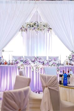 Our sheer draping panels provide a beautiful backdrop at weddings and makes a statement when draped around sweetheart tables. Pair sheer event drapes with floral chandeliers, table skirts and floral table arrangements to create the sweetheart table of your wedding dreams. #lavenderweddingtheme #lavenderwedding #lavenderweddingideas #springweddingcolors #springwedding Lavender Wedding Theme, Spring Wedding Colors, Purple Wedding, Wedding Dreams, Dream Wedding, Wholesale Tablecloths, Sweetheart Table Decor, Table Skirts, Floral Chandelier
