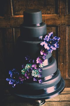 Five tier black cake with wired sugar paste flowers. Lovely and unusual.