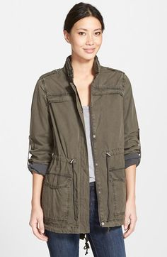 Free shipping and returns on Levi's® Lightweight Cotton Hooded Utility Jacket at Nordstrom.com. Military inspiration defines a lightweight cotton jacket equipped with a stowaway hood and cinched with drawcords at the waist and fishtail hem. The long sleeves can be rolled and fastened with button-tabs to expose stripe-printed contrast fabric.