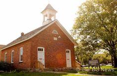 A one-room schoolhouse built in 1875 now serves as an Educational Memorabilia Center at BGSU.
