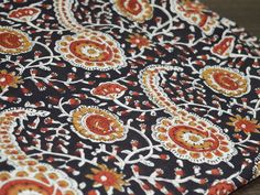 Vegetable Dye Soft Hand loom Cotton Fabric with Brown, Rust and Mustard Color Floral Motifs over beige cream base background. This is 100% cotton fabric made of pure cotton yarn printed using hand...
