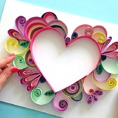Paper quilling is the craft of rolling strips of paper and gluing them onto a surface to create an intricate three-dimensional piece of artwork. 3d Quilling, Quilling Videos, Paper Quilling For Beginners, Quilled Roses, Paper Quilling Tutorial, Paper Quilling Cards, Paper Quilling Patterns, Quilled Paper Art, Quilling Techniques