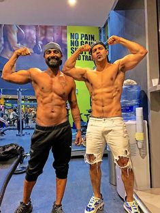 fitness freak varun dhavan showing his biceps with choreographer remo dsouga Bollywood Cinema, Bollywood Actors, Hollywood Actresses, Actors & Actresses, Humpty Sharma Ki Dulhania, Student Of The Year, Happy New Year Images, Celebrity Biographies, Varun Dhawan