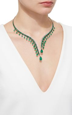 This scintillating necklace, intricately embellished with round brilliant diamonds, features lavish Gemfield sourced Zambian emeralds cascading throughout.