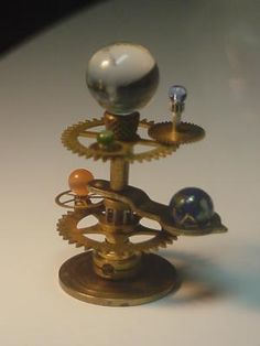 """""""planetariums""""..not a tutorial but could easily be reproduced with watch/clock parts.."""