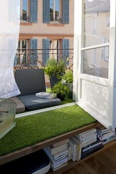 Add a little (fake) greenery to an indoor window seat to make a small patio seem larger.