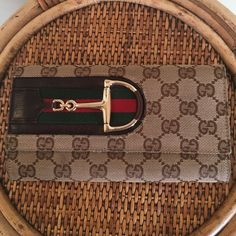 GUCCI HASLER CONTINENTAL WALLET This wallet is in great used condition.  There is some minor wear from normal use.  Small stain on the back shown in picture #2.  Minimal wear to the fabric (no rips or tears) minor wear on the inside leather from normal use.  All stitching is intact no peeling. 6 credit card slots, 3 currency slots, zippered coin compartment. Serial number is 138032 203887.   I also have the matching handbag listed. 🚫TRADES🚫LOWBALL Gucci Bags Wallets