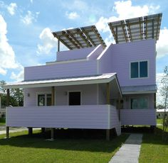 A canopy of solar panels provides power for the building and also shelters two terraces on the roof.