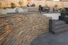 Stoneface Drystack Walling, Copper Slate. Coping is SYMPHONY, Dark paving cut to size