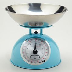 Retro aqua metal kitchen scale with red numbers and stainless steel bowl