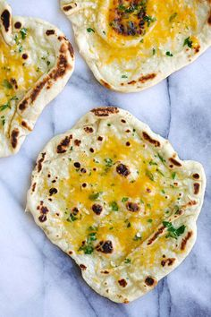 Cheesy Garlic Naan - homemade naan topped with garlic and cheddar cheese. Cheesy, buttery, garlicky naan that you can't stop eating | rasamalaysia.com