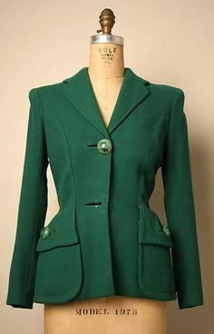 Jacket  Designer:Elsa Schiaparelli (Italian, 1890–1973) Date:ca. 1952 Culture:French Medium:wool, metal, plastic, synthetic Credit Line:Gift of Miriam Whitney Coletti, 1984 Accession Number:1984.587.9