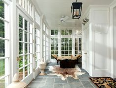 A sunroom can act as a second living room. Sunrooms support leisurely living and can serve many functional purposes! #coachbarn #design #furniture