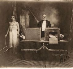 Photograph of the magician Professor Herrmann sawing a lady in half, 1923