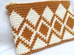 This 100% handmade, crocheted zipper pouch is perfect to use as either a wallet, pencil case, cosmetics bag or so much more! Its big enough to fit a