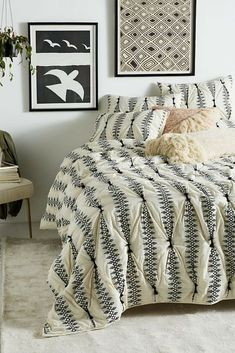 Blending minimalist and bohemian aesthetics, this textured bedding is a luxe update for your space. #boho #decor #quilt #bedding #ad