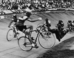 "Last Lap of the 1958 Tour de France  Original caption: Editor's notes: Paris, July 19, 1958. 45th ""Tour de France"" (Brussels-Paris). Dramatic fall of the French rider Andre Darrigade (who'd already won 5 laps) on the Parc des Princes track, at the arrival of the 24th and last lap disputed between Dijon and Paris. He slams into a track official who was too close to the track."