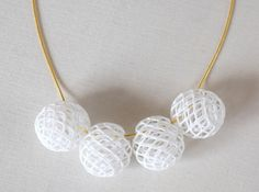 Bud Bead 3d printed in this image, the beads are chained up on a gold plated snake chain