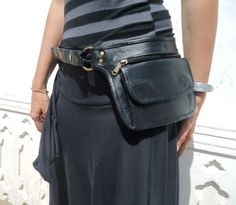 Leather Utility Belt, Leather Belt Bag, Hip Bag, Pouch Belt, Pocket Belt in Black- HB11N * Free Shipping* This Utility Belt bag is light and compact and has lots of room to fit your phone, keys and more. It has one large pocket that closes with two magnet buttons and a zipper pocket in the front and a hidden zipper pocket in the back You can use the bag as a hip belt or a shoulder bag. * Free shipping for USA and Canada till July 15 * Front zipper pocket: 6.x 4 Front flap pocket: 5.5x 3....