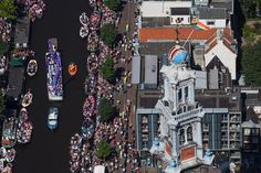 Amazing aerial picture of the Canal Parade in Amsterdam!  Photo: Cris Toala Olivares/ Andreas Cultuur Fonds #europride #canalparade #amsterdam #iamsterdam