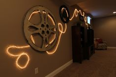 BIA Parade of Homes Photo Gallery Hate the design love the concept. The lights would be great around trim work in a media room Movie Theater Theme, Theater Room Decor, Movie Decor, At Home Movie Theater, Movie Theme Decorations, Home Cinema Room, Home Theater Rooms, Home Theater Design, Home Theater Seating
