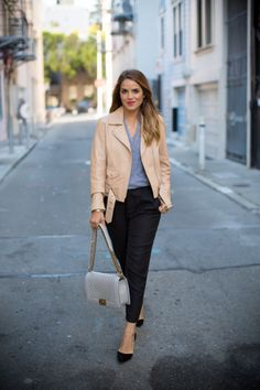 Pair a leather jacket with trousers and pumps to get this look.
