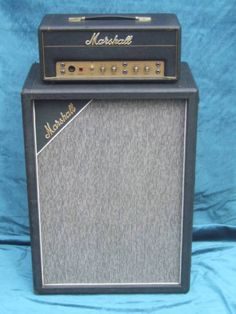 "Marshall JTM 45 = first guitar amplifier made by Marshall. First produced in 1962, it has been called a ""seminal"" amplifier handmade in all-aluminum chassis by Ken Bran & Dudley Craven. Because of its power, Marshall built it as a head, with a separate 4x12"" cabinet with Celestion speakers. Amplifier based on Fender Bassman using KT66 vacuum tubes or valves and 12AX7 tubes (known in Britain as ECC83 valves) in the pre-amplification stage - Research by DdO:)…"