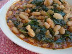 Braised Cannellini Beans With Onions and Arugula