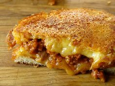 grilled cheese sloppy joe, brioche, over low heat, poke holes for cheese to melt through and form crust