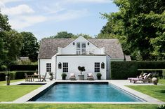 A young family resides in this restored circa-1840s farmhouse in Bridgehampton; deLashmet & Assoc. designed the grounds.