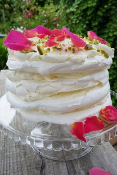 Layered rosewater meringue with saffron, nutmeg, and rose infused whipped cream.