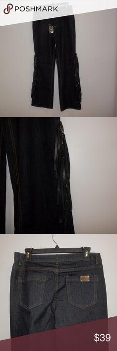 "NWT Midnight Velvel Ultra Dark Wash Fringe Jeans Midnight Velvet Sz 10 Ultra dark wash boot cut jeans with black ""leather"" fringe. New with tags Midnight Velvet Jeans Boot Cut"