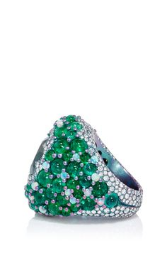 This **Arunashi** ring features exquisite vibrant stones highlighted by decadent…