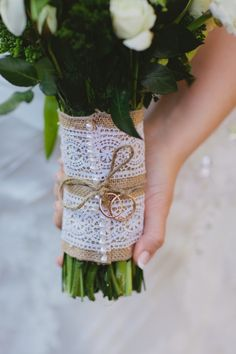 the wedding rings (belonging to her mother and late father) that her mother tied on her daughter's bouquet. such a sweet and simple detail that I'm sure meant so, so much to the bride on her wedding day. they both walked her down the aisle that way. (photo by Marvelous Things Photography)