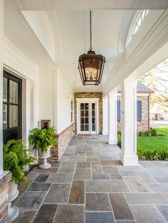 For the flooring: Stone Home Exterior with white siding and stone porch flooring. Stone Home Exterior. Legacy Custom Homes, Inc. Porch Tile, Porch Flooring, Outdoor Flooring, Stone Flooring, Tile Patio Floor, Stone Siding, Luxury Flooring, Wood Siding, Dream Homes
