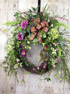Wonderful Majenta Purple Front Door Wreath with twiggy vines and wildflowers is like taking a walk in the woods. Perfect as a Spring Wreath or Summer Wreath. Magical Majenta ! Beautiful wreath of tangled twigs and vines and ferns all encompassing a sweet Birds Nest with Eggs. Pink,