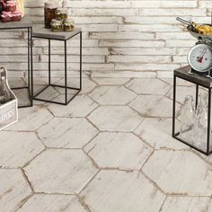 Craft a countryside-inspired kitchen backsplash or refresh the powder room with this stylish tile, featuring a hexagon design and weathered white finish.
