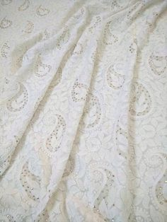 Off White beautifully hand crafted running fabric in pure georgette. The fabric can be used for making a kurta with both back and front embroidery. it has beautiful shadow work combined with golden mukiash/kamdani Fabric:Pure georgette (60 grams) Technique:Hand Embroidery  Since it is a hand crafted item, there can be slight variations in embroidery.