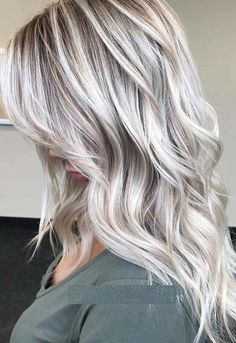 Whether you're currently wearing short or long blonde haircuts you can wear these beautiful ice cream blonde hair colors and hairstyles in 2018. Look in this post how beautiful this color is. This is one of the hair colors which really complete the beauty of your haircut styles.