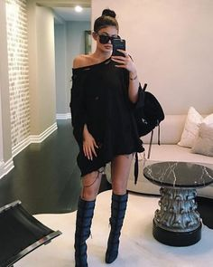 Casual sweatshirt dress | chic one-shoulder black outfit with knee-length boots | street style outfit idea