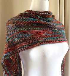 Free Knitting Pattern for Stitch Sampler Shawl - Rectangular wrap with with sections of dropped stitches, slipped stitch patterns, eyelets, and other stitches. Designed by On This Day Designs. Pictured project by OrangeSmoothie who used 2 colorways of variegated yarn