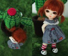 Cute doll, but I love the idea of a crocheted cactus