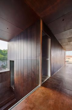 Gallery House is a renovation by Raúl Sánchez Architects for the Mas Blanch i Jové winery in Catalonia, featuring corten steel walls and a circular window. Raul Sanchez, Barcelona Apartment, Weathering Steel, Huge Windows, Minimal Home, Ground Floor Plan, Corten Steel, Steel Wall, Architecture Details