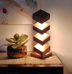 Wooden Accent Table Lamp - Solid Handcrafted Exotic Hardwood Column with LED Lighting Wooden Accent Table Lamp - Solid Handcrafted Walnut Column with LED Lighting Wall Clock Wooden, Wooden Lamp, Cool Lighting, Lighting Design, Wooden Shelf Design, Origami Lights, Hardwood Table, Wood Columns, Cardboard Sculpture