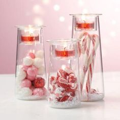 "Popular candle holders rendered in a smaller size! Fill the glass vessels with your own decorative accents and finish by adding the votive cup on top. Light from a votive or tealight, sold separately, sets the trio aglow. Set includes one of each height: 5"", 6"", and 7"". P91205"