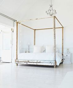 Interesting canopy bed built from 'salvaged' wood...hhmm