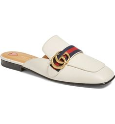 Signature goldtone interlocked Gs adorn the classic blue-and-red webbing that wraps around the '70s-inspired square-toe silhouette of this fashion-forward mule loafer from Gucci.