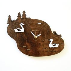Swan friends swimming sweetly in the serene lake. Oh and its a clock. - Made from stained and painted Birch plywood  - 10 x 8  - White hour and minute