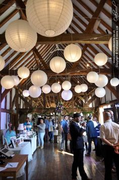 The fabulous Loseley Park Tithe Barn dressed for their wedding fayre. Showcasing our disco lanterns, fairy lights and chandelier wedding lighting