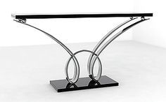 Taylor Llorene | A sculptural free standing double looped console table of magnificent proportions shown in highly polished stainless steel modeled by hand http://modernconsoletables.net